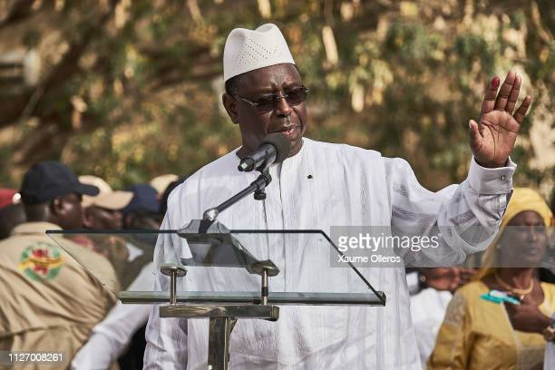 President Macky Sall greets the crowd as he speaks to the media after casting his vote at a polling station on February 24 2019 in Fatick Senegal 67...