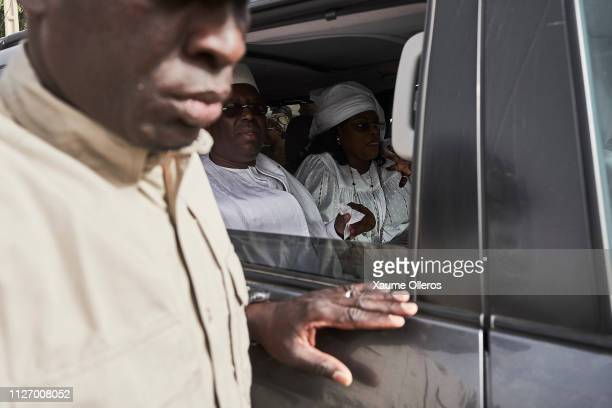 President Macky Sall leaves in a car after casting his vote at a polling station on February 24 2019 in Fatick Senegal 67 million voters are expected...