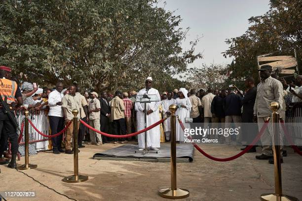 President Macky Sall speaks to people after casting his vote at a polling station on February 24 2019 in Fatick Senegal 67 million voters are...