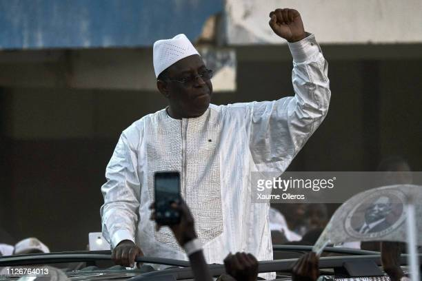 President Macky Sall waves to the crowd as he enters Leopold Sedar Senghor stadium duringhis final rally on February 22 2019 in Dakar Senegal Senegal...