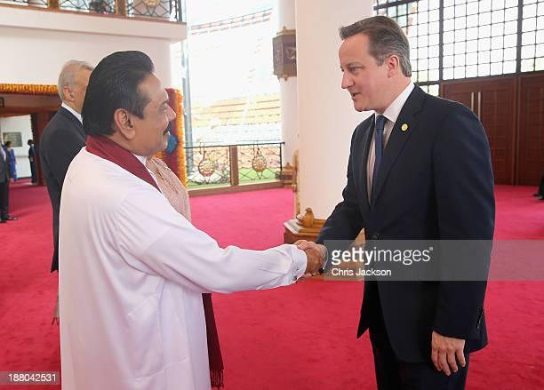 President Mahinda Rajapaksa of Sri Lanka greets British Prime Minister David Cameron ahead of the Commonwealth Heads of Government 2013 Opening...