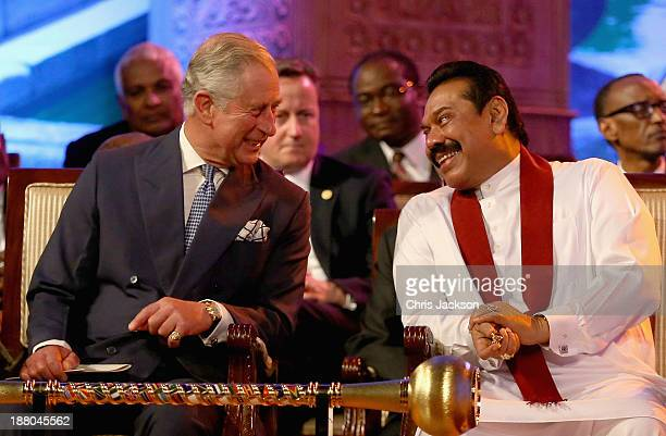 President Mahinda Rajapaksa of Sri Lanka laughs with Prince Charles, Prince of Wales as British Primeminister David Cameron looks on during the...