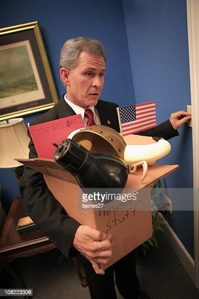 President Man Leaving Office with Packing Box