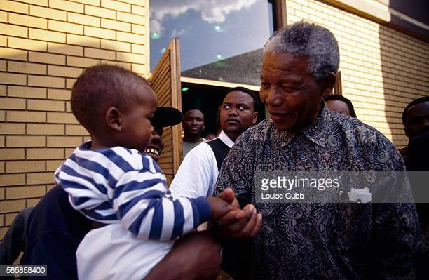 President Mandela greets children and adults in Thokoza at the beginning of the campaign for November elections President of South Africa and...