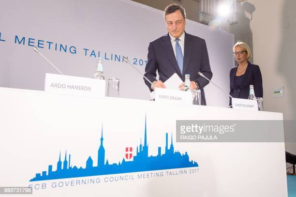 ECB President Mario Draghi and ECB spokeswoman Christine Graeff arrive for the press conference after the Governing Council meeting in Tallinn on...