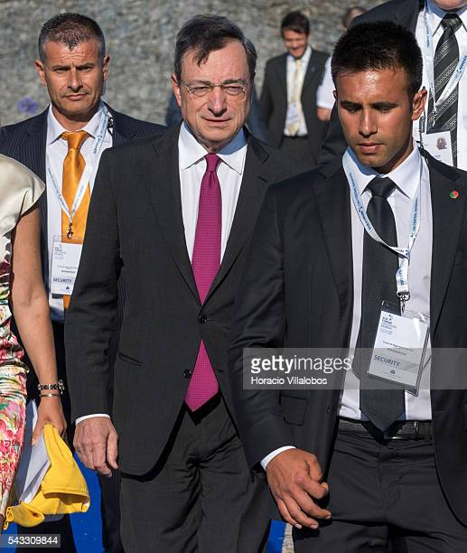 President Mario Draghi arrives accompanied of ECB Director General Communications Christine Graeff and flanked by security guards to participate in...