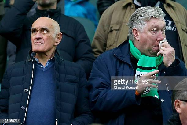 President Martin Kind and legend player Dieter Schatzschneider of Hannover stand on the tribune during the Bundesliga match between Borussia...