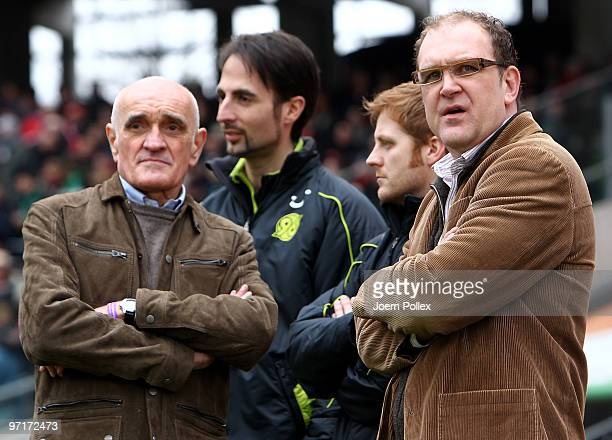 President Martin Kind and manager Joerg Schmadtke look on prior to the Bundesliga match between Hannover 96 and VfL Wolfsburgat AWDArena on February...