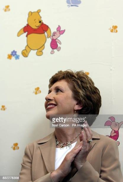 President Mary McAleese claps as she officially opens the new School Street Family and Childcare Centre in the Liberties area of Dublin