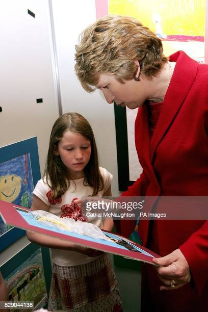 President Mary McAleese speaks to Abbie Walsh aged 6 at the 50th Texaco Children's art competition in the Burlington Hotel Dublin The four winning...