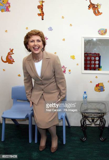 President Mary McAleese takes a seat before officially opening the new School Street Family and Childcare Centre in the Liberties area of Dublin