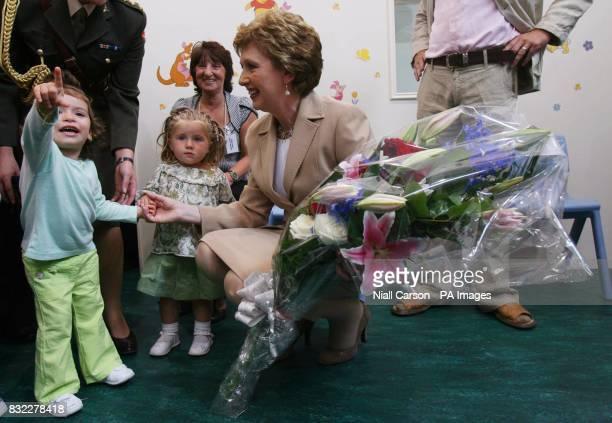 President Mary McAleese talks to Chelisel Doljescan and Emma Lennox as she officially opens the new School Street Family and Childcare Centre in the...