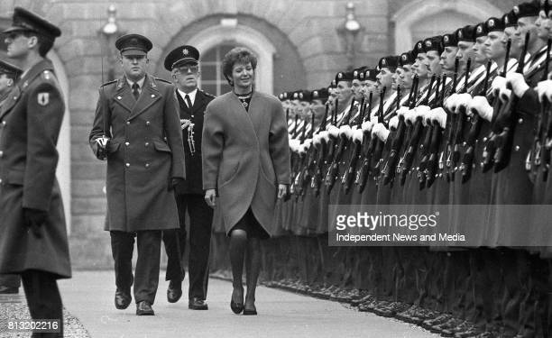 President Mary Robinson inspects a Guard of Honour drawn from the 2nd Infantry Battalion Cathal Brugha Barracks accompanied by Captain Tom Boyce and...