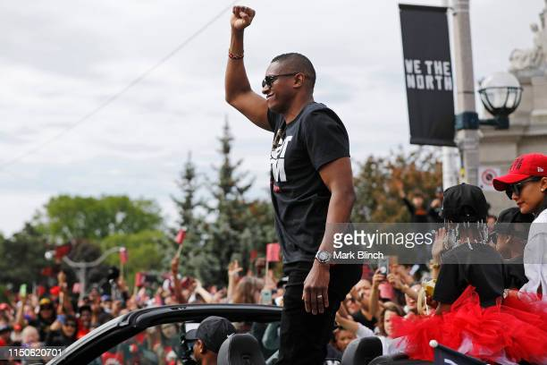 President Masai Ujiri of the Toronto Raptors looks on from the team vehicle during the Toronto Raptors Championship Victory Parade on June 17, 2019...