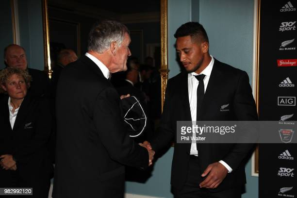 President Maurice Trapp presents All Black Shannon Frizell with his test cap following the International Test match between the New Zealand All...