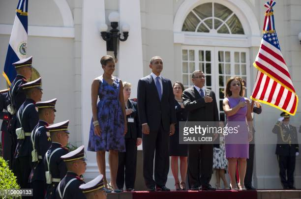 President Mauricio Funes of El Salvador and his wife Vanda Pignato stand alongside US President Barack Obama and First Lady Michelle Obama during the...