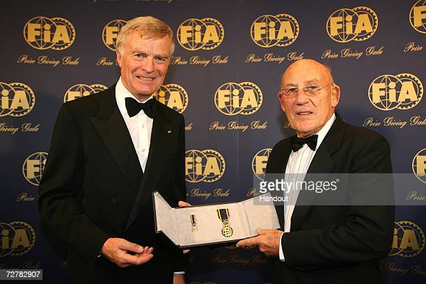 President Max Mosley presents Sir Stirling Moss with the FIA Academy Gold Medal at the 2006 FIA Gala Prize Giving Ceremony held at the Salle des...