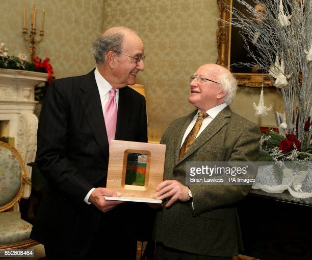 President Michael D Higgins presents Senator George Mitchell with his Presidential Distinguished Service Award for the Irish Abroad at a ceremony in...