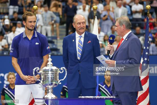 President, Michael McNulty, speaks as Daniil Medvedev of Russia and Stan Smith look on during the trophy ceremony after Medvedev defeated Novak...