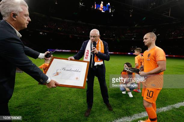President Michael van Praag honors Wesley Sneijder of Holland during the International Friendly match between Holland v Peru at the Johan Cruijff...