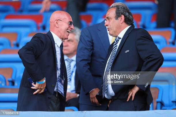 President Michel Platini and Arrigo Sacchi chat prior to the UEFA European U21 Championship Group A match between Norway and Italy at Bloomfield...