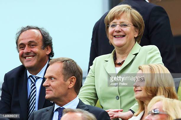 President Michel Platini and German Chancellor Angela Merkel smile during the UEFA EURO 2012 quarter final match between Germany and Greece at The...