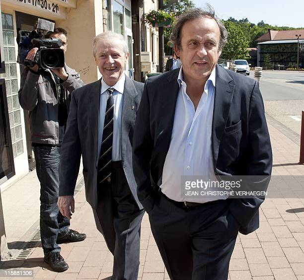 UEFA president Michel Platini and his father Aldo arrive on June 11 prior to attending a general assembly of the Lorraine Football League in Joeuf...