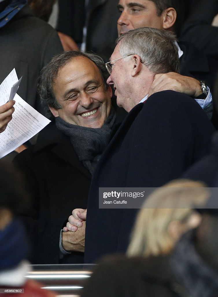 President Michel Platini and Sir Alex Ferguson attend the UEFA Champions League round of 16 match between Paris Saint-Germain FC and Chelsea FC at Parc des Princes stadium on February 17, 2015 in Paris, France.