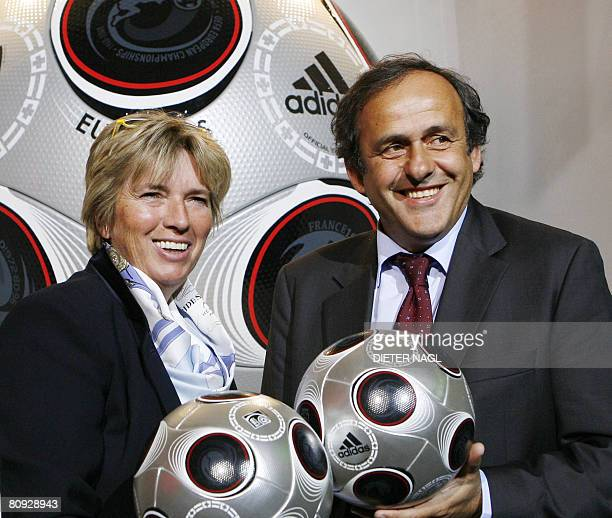 President Michel Platini and Vienna's Vice Mayor Grete Laska hold official balls for the UEFA EURO 2008 final game on April 30, 2008 in Vienna....