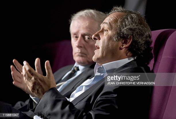 UEFA president Michel Platini flanked by his father Aldo gives an interview to French television after attending a general assembly of the Lorraine...