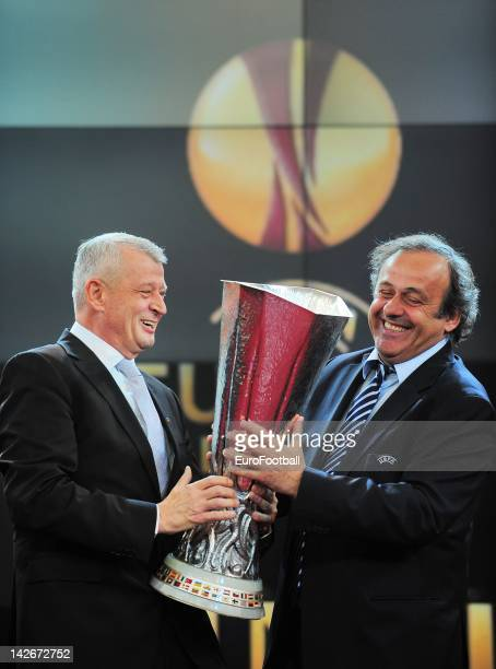 President Michel Platini give the trophy to Mayor of Bucharest Sorin Oprescu during the UEFA Europa League trophy handover ceremony at the National...