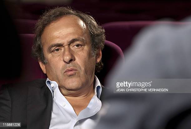 UEFA president Michel Platini gives an interview to French television after attending a general assembly of the Lorraine Football League on June 11...