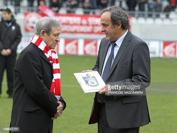 President Michel Platini gives the European soccer union prize to French former soccer legend Raymond Kopa prior to the French L2 football match...