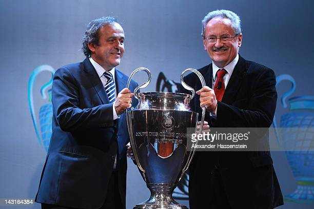 President Michel Platini hands over the UEFA Champions League winners trophy to Christian Ude Lord Mayor of Munich during the UEFA Champions League...