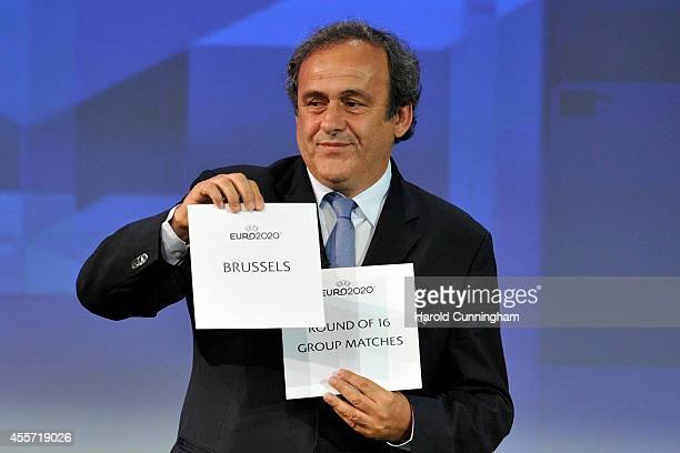 President Michel Platini holds up the card for Brussels who will host a round of 16 and group stage matches of the EURO 2020 during the UEFA EURO...