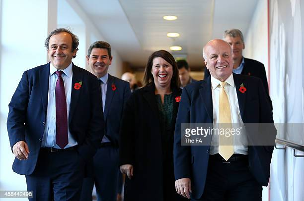 President Michel Platini is shown around the premises by FA Chairman Greg Dyke , St George's Park Managing Director Julie Harrington , Managing...