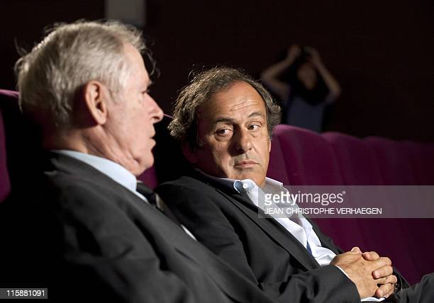 UEFA president Michel Platini looks at his father Aldo as he gives an interview to French television after attending a general assembly of the...