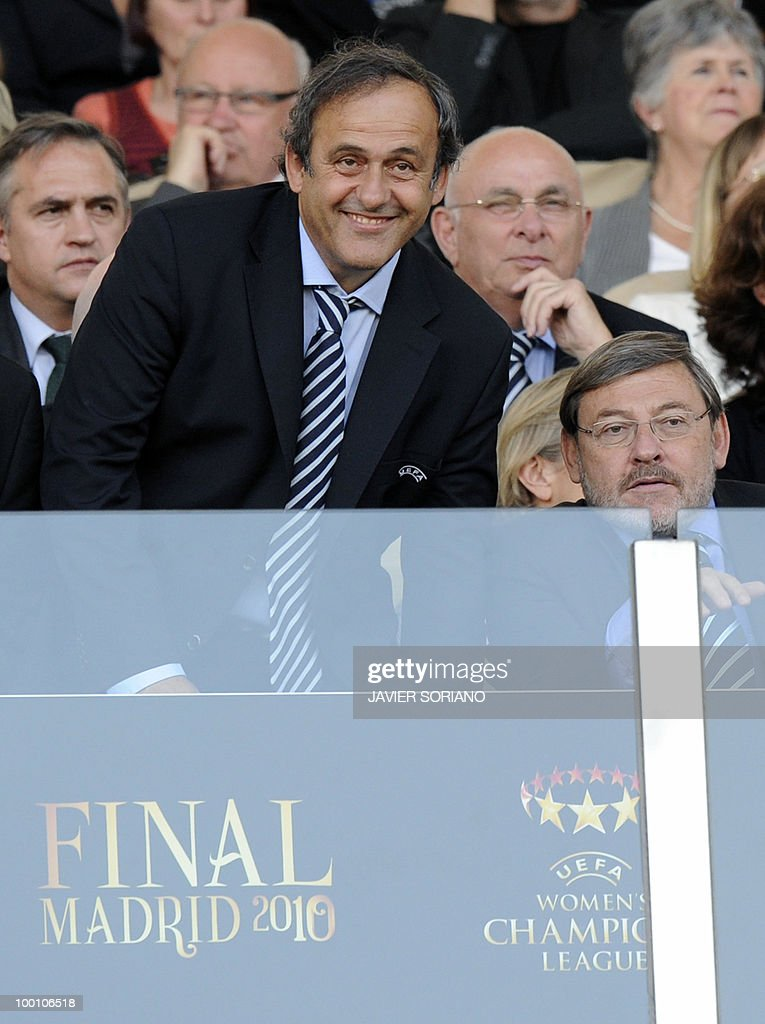 President Michel Platini (L) of France smiles next to Spanish State Secretary of Sport Jaime Lisavetswky (R) during the UEFA women's Champions League final football match beetwen Olympique Lyonnais and FFC Turbine Potsdam at the Coliseum Alfonso Perez stadium in Getafe on May 20, 2010. near Madrid.