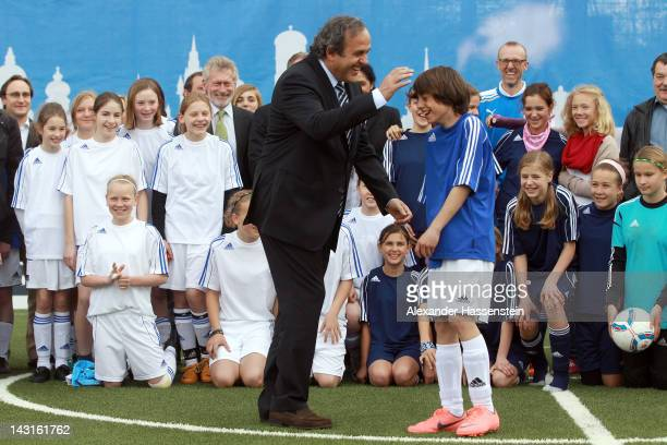 President Michel Platini plays football with kids after handing over a minipitch to Munich host city of the UEFA Champions League and UEFA Women`s...