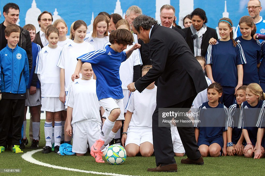 President Michel Platini plays football with kids after handing over a mini-pitch to Munich, host city of the UEFA Champions League and UEFA Women`s Champions Legaue final on April 20, 2012 in Munich, Germany.