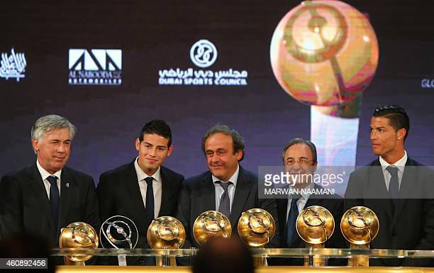President Michel Platini poses on stage with Real Madrid football club's President Florentino Perez next to Real Madrid's manager Carlo Ancelotti and...