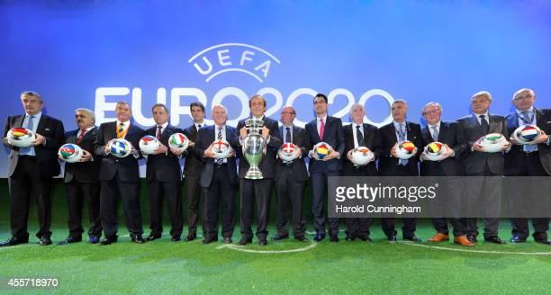 President Michel Platini poses with European football association chairmen following the UEFA EURO 2020 Host Cities Final announcement ceremony held...