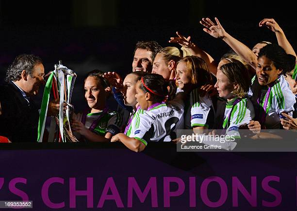 President Michel Platini presents Captain Nadine Kessler of VfL Wolfsburg with the trophy after victory in the UEFA Women's Champions League Final...