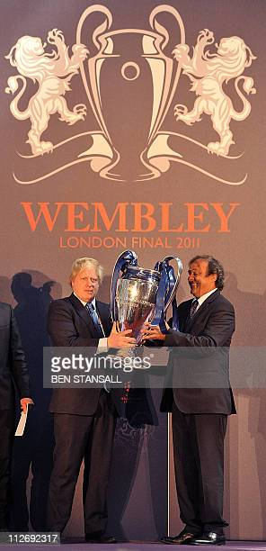 President Michel Platini presents the UEFA Champions League Cup to Mayor of London Boris Johnson during a 'handover' ceremony at the Guildhall in...