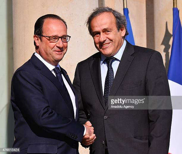 President Michel Platini shakes hands with French President Francois Hollande as leaves the Elysee Palace after their meeting on June 10 2015 in...