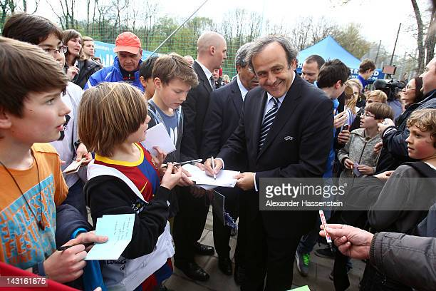 President Michel Platini signs autographs after handing over a minipitch to Munich the host city of the UEFA Champions League and UEFA Women`s...