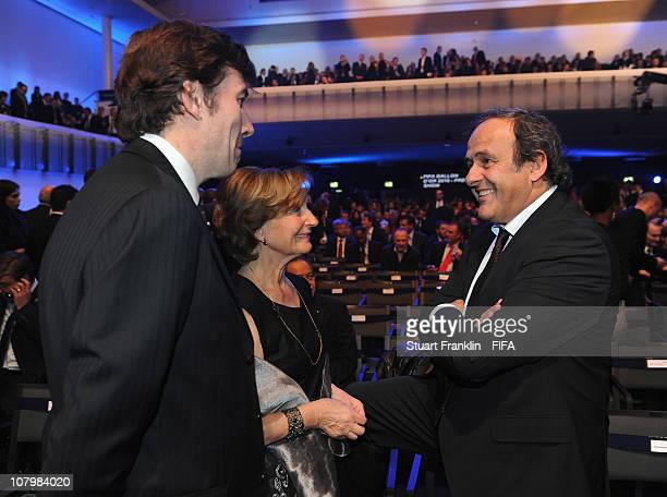 UEFA president Michel Platini talks to Francois Moriniere of French ASO group and owner of French sport daily l'Equipe and President of the Amaury...