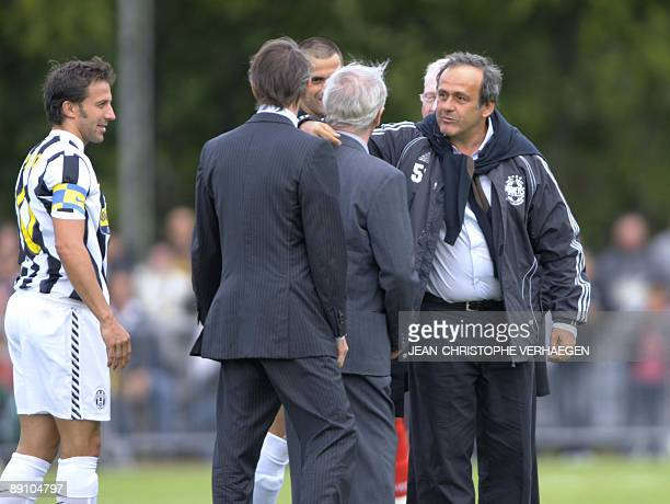 President Michel Platini talks to his father Aldo Platini on July 19 in Joeuf eastern France prior to the start of the friendly football match...
