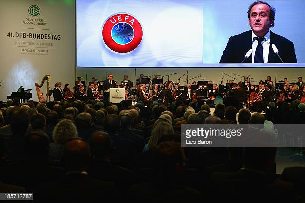 UEFA president Michel Platini talks to the audience during the DFB Bundestag at the NCC Nuremberg on October 24 2013 in Nuremberg Germany