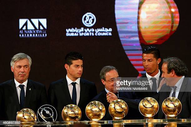 President Michel Platini talks with Real Madrid football club's President Florentino Perez next to Real Madrid's manager Carlo Ancelotti and players...